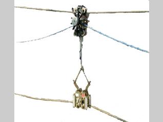固定自動解除式電線支持及びこれを用いた搬送延線工法